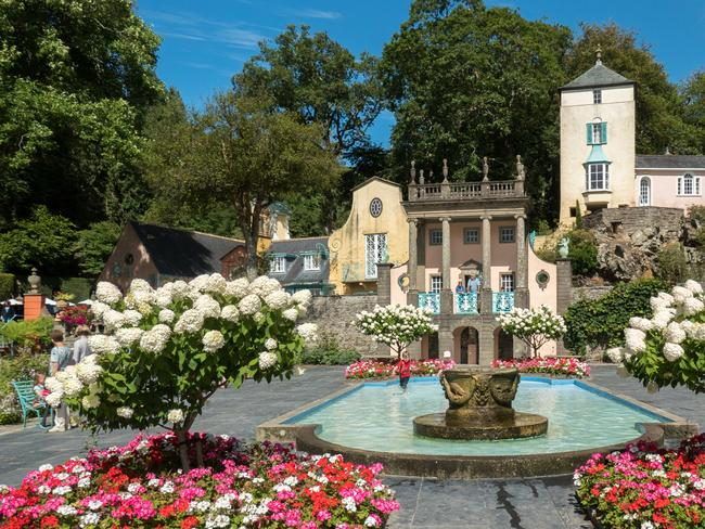 PORTMEIRION There is nowhere else like it — Portmeirion was the vision of Welsh architect Cloug Williams-Ellis, who built it from the 1920s-1970s and created a pastel-coloured Italianate dreamscape on the coast of north Wales. It's a magical place to visit. Stay in the Gothic castle Castell Deudraeth.