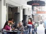 Customers at Tropicana Cafe on Victoria Road, Darlinghurst, Sydney.