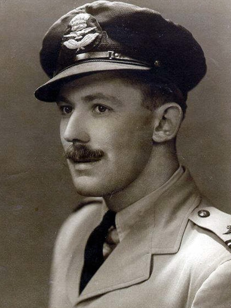 1940s : Pilot Flight-Lieutenant Bryan Rofe in uniform in early 1940's photo, has documented in his diary the trials of his RAAF men, trying to escape Japanese invasion of Timor in 1942 during World War II. Australian Armed Forces / Air Force WWII Historical P/L