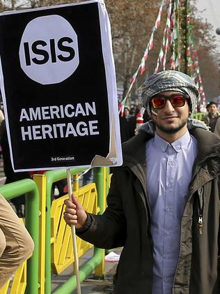An Iranian holds an anti-US placard in an annual rally commemorating the anniversary of the 1979 Islamic revolution. Picture: AP