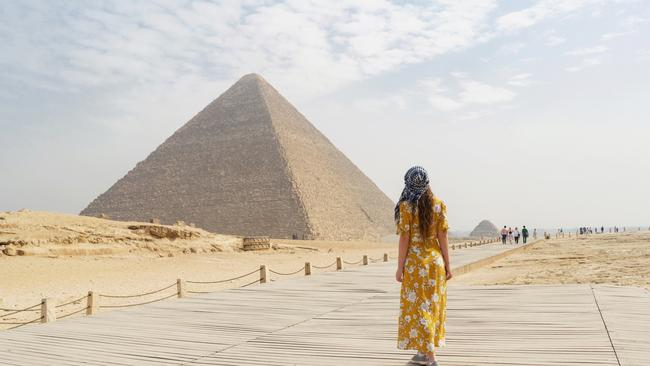 Rear view of a female tourist enjoying a tour to the Pyramids of Giza in Egypt.  Picture: iStock  Catherine Best, Sightseeing 101, Escape