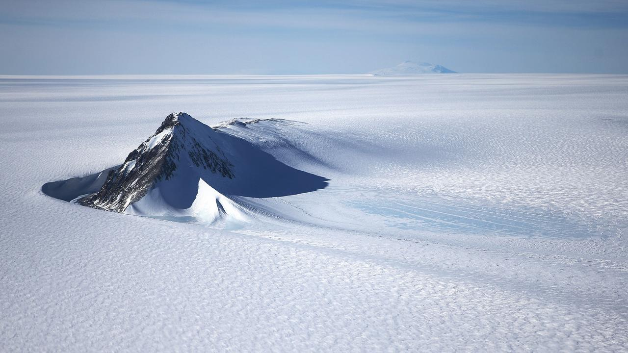 Part of the West Antarctic Ice Sheet and mountains. During the last Ice Age, the polar regions, including Antarctica, cooled more than the tropics. Picture: Getty