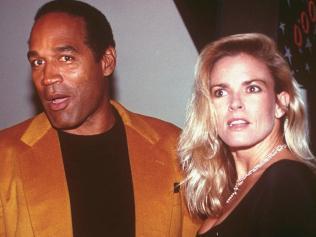 OJ Simpson and his wife, Nicole Brown Simpson, in the year before her murder : AP PicPaul/Hurschmann