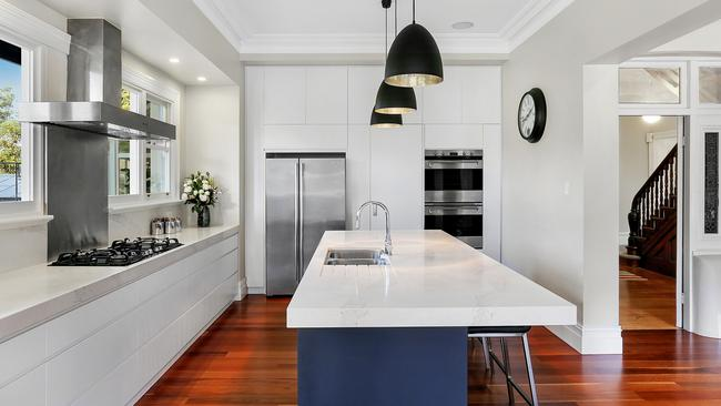 The revamped kitchen has stone benchtops and Smeg dual ovens.