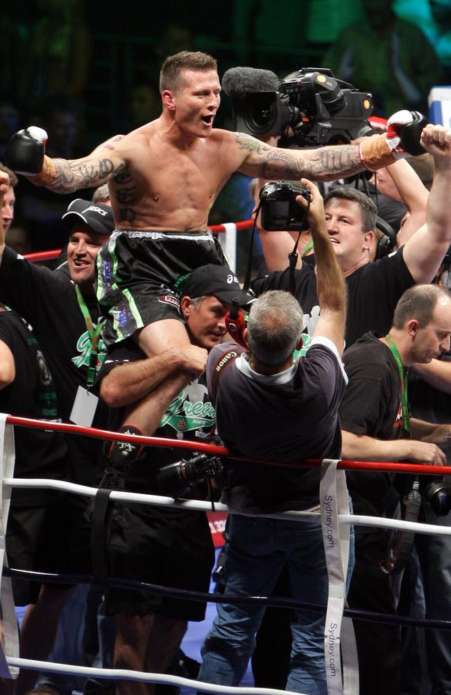Danny Green celebrates at the end of his IBO world cruiserweight match against Roy Jones Jnr.