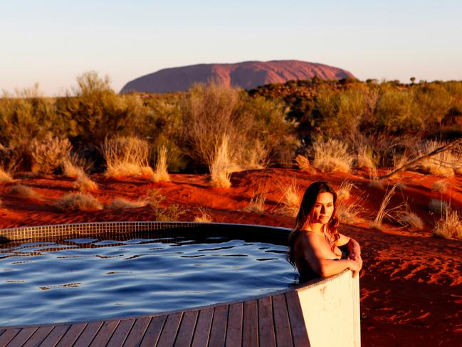 """LONGITUDE 131, ULURU, NT: Not too many tents boast their own swimming pool. Then again, not many tents offer views of both Uluru and Kata Tjuta – in fact, just one. Opened this year, the Dune Pavilion is the newest ultra-luxurious addition to Uluru's most exclusive accommodation site, Longitude 131. While the tented suite's interiors are stunning, it's out on the deck, in the private plunge pool overlooking the Outback frontier where you really appreciate what a $5500 a night price tag gets you. No surprises that this stunning oasis has been labelled """"the ultimate in desert glamour"""". longitude131.com.au"""