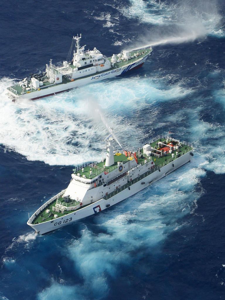 Japanese and Taiwanese patrol boats discharge water at each other near disputed the Senkaku/Diaoyu islands in 2012. Picture: Kyodo News/AP