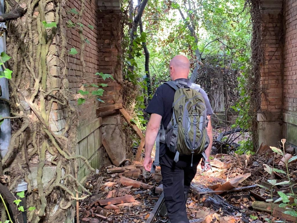 FINDERS BEEPERS HISTORY SEEKERS / CATERS NEWS (PICTURED: ANDY THOMPSON EXPLORING POVEGLIA ISLAND) Eerie footage captures inside the 'the world's most haunted island' - which is home to mass burial plague pits and an asylum. Poveglia Island, off the coast of Venice and Lido, Italy, is nicknamed the 'Island of Ghosts' due to its grizzly past, which first started when it was used as a quarantine station for people with the plague. People were dragged kicking and screaming to the island if they showed even the slightest symptoms of the Black Death, according to legend. The 18-acre plot was also used as a mass burial ground where some 160,000 victims are thought to have been burned to stop the spread of the disease. SEE CATERS COPY