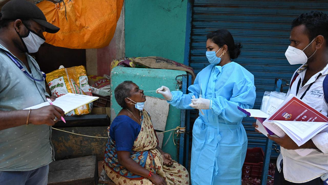 A health worker takes a swab sample from a woman at a market in Chennai in Covid-ravaged India. Picture: AFP