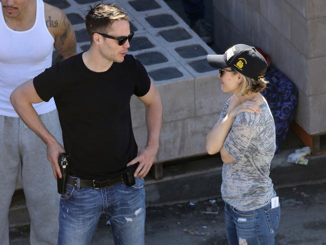 Getting close ... Rachel McAdams chats with Taylor Kitsch on the set of True Detective.