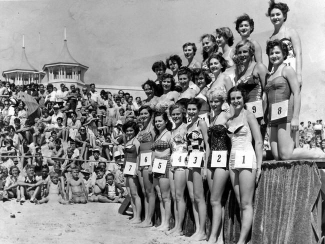 Contestants line up for the 1954 Sunday Advertiser Beach Girl Quest at Semaphore beach.