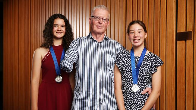 Colin Bailey with Aja and Ayumi. The two friends came to his aid and even made a makeshift tourniquet from a horse lead. Picture: Tim Hunter.