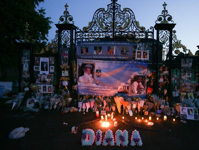 Floral tributes, candles and photographs are seen left outside one of the entrances of Kensington Palace in London on August 31, 2017, to mark the 20th anniversary of the death of Diana, Princess of Wales. Picture: AFP.