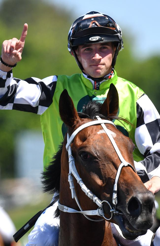 Jockey Lee Magorrian salutes after his win on Exoteric. Picture: AAP