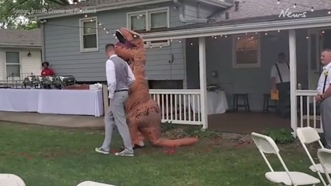 Moment maid-of-honour rocks up as T-Rex