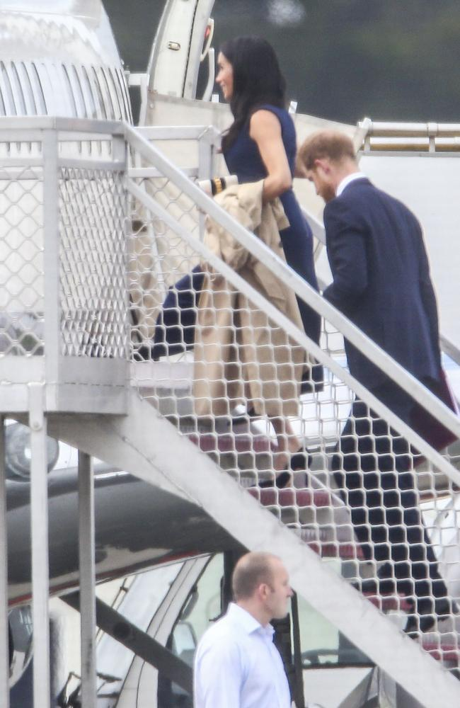 Prince Harry and Meghan Markle arrive at the Sydney airport jet base for their RAAF flight to Melbourne.