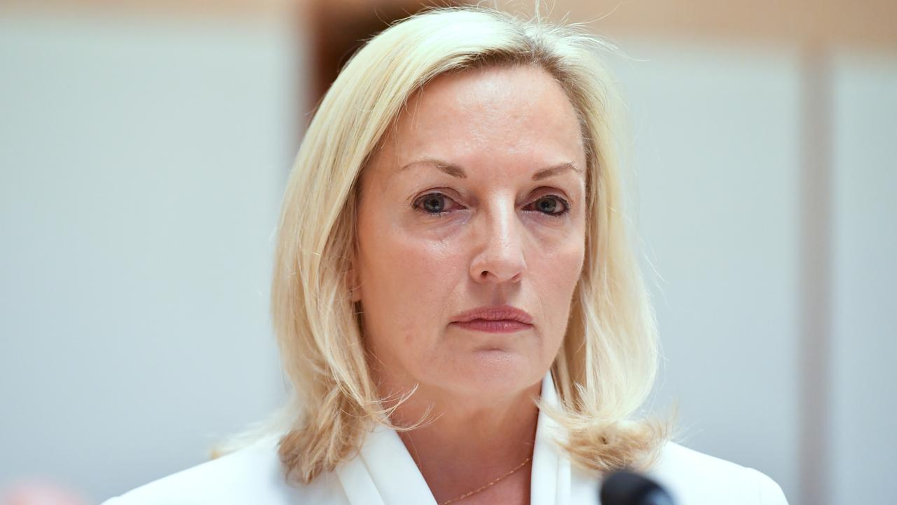 Former Australia Post CEO Christine Holgate appeared before a Senate inquiry into changes at Australia Post, at Parliament House in Canberra, Tuesday, April 13. Her support in the postal service wore white, to call out workplace bullying.