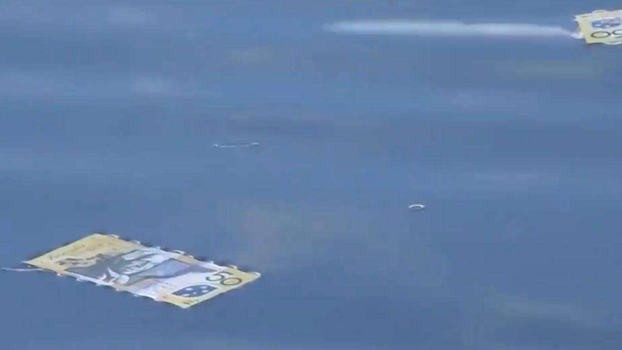 Cash was seen floating down a river near Wollongong. Picture: Channel 9.