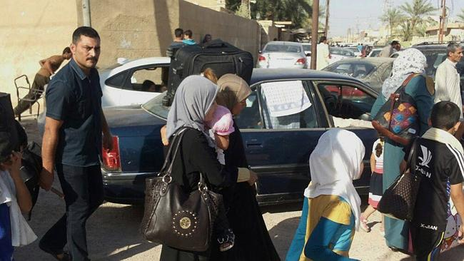 Evacuation ... civilians flee their hometown of Ramadi before Islamic State militants searched door-to-door for policemen and pro-government fighters. Picture: AP Photo