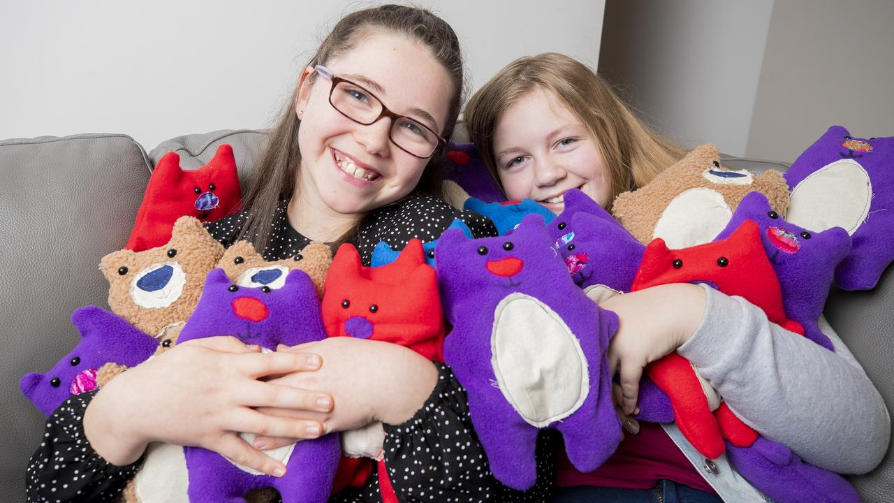 Grace and Chloe with some of the ISO bears they have made. Picture: Richard Jupe