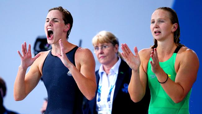 Bronte Campbell and Melanie Schlanger of Australia cheer their teammates on their way to gold in the 4x100m freestyle relay.