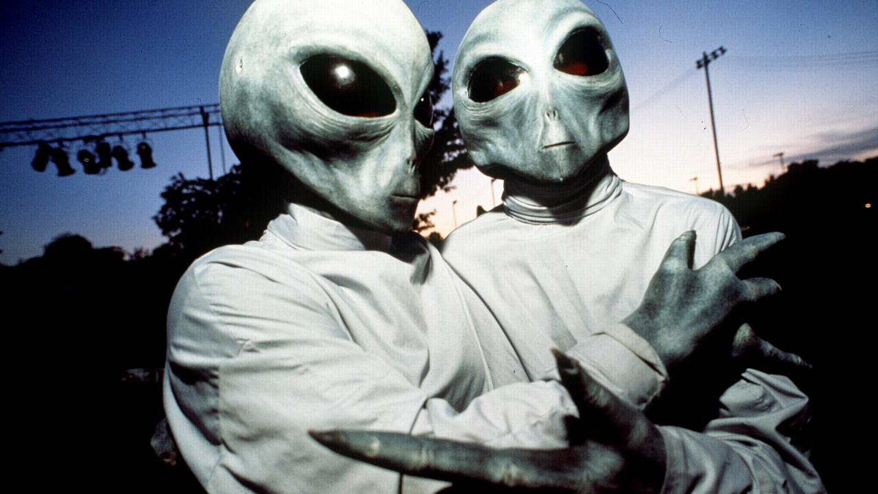 07/08/2008 LIBRARY: 07/08/2008 LIBRARY: Attitude Conspiracy 19: 08/08/1996 Two people dressed in alien costumes for 1996 UFO Festival in Roswell, New Mexico, US.
