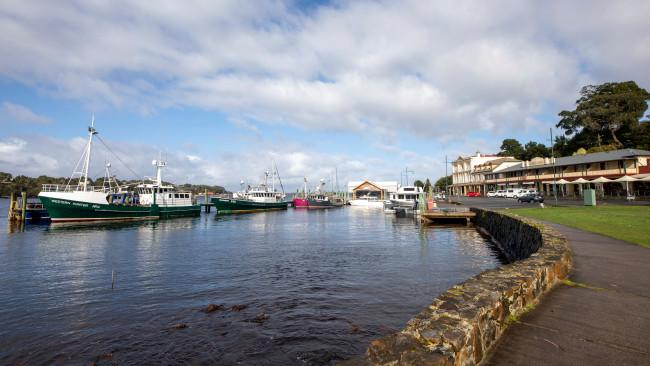 Strahan HarbourStrahan, Tasmania On the edge of the Tasmanian Wilderness World Heritage Area, Strahan Harbour is a hub for boats offering cruises to the stunning temperate rainforests of the Gordon River. Picture: Tourism Australia