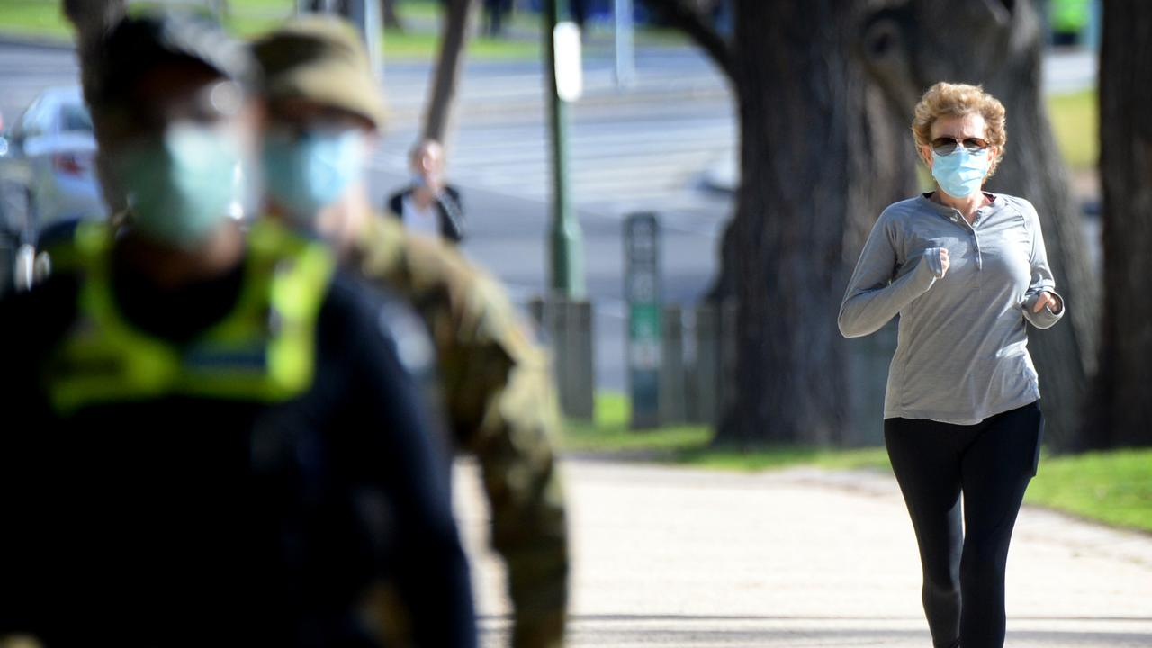 Police and ADF personnel patrol the Tan track in Melbourne. Picture: NCA NewsWire / Andrew Henshaw