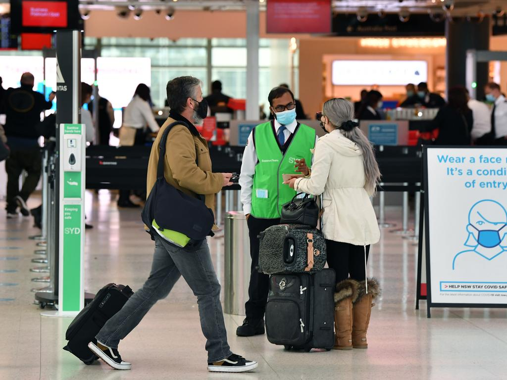 passenger speaks to a Covid Marshal at Sydney Domestic Airport. Picture: NCA NewsWire/Joel Carrett