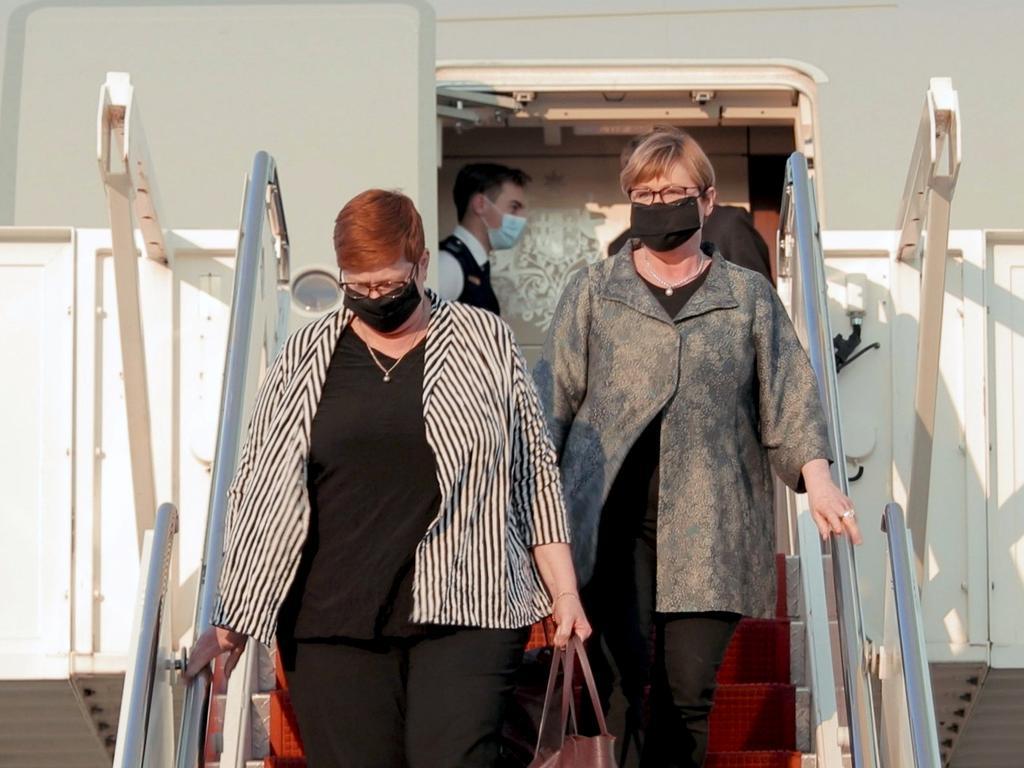 Marise Payne and Linda Reynolds arrive in Washington wearing face masks.