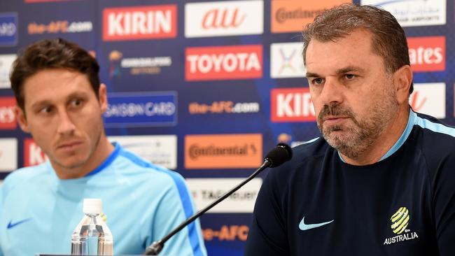 Socceroos coach Ange Postecoglou and midfielder Mark Milligan at a press conference in Saitama on Wednesday ahead of the World Cup qualifier against Japan.