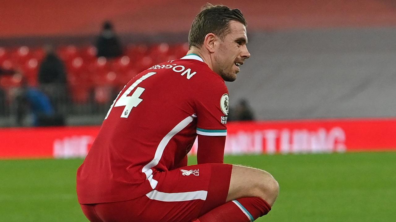 Liverpool's Jordan Henderson wrote on behalf of the playing group. (Photo by Paul ELLIS / POOL / AFP)