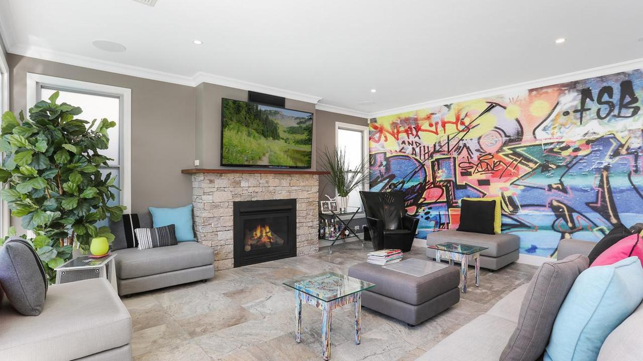 The home at 36 Trevilyan Ave, Rosebery has an artistic, graffiti feature wall.