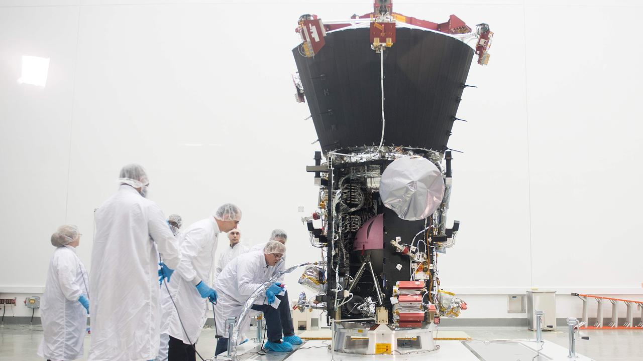Engineers examine the Parker Solar Probe at NASA Goddard Space Flight Center in Maryland, US, in March 2018 before the spacecraft launched. Picture: AFP