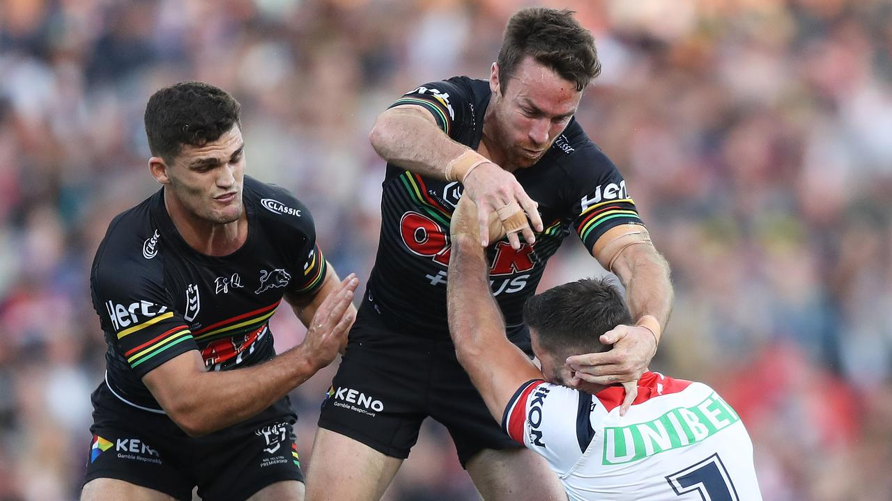 James Maloney puts a bit hit on James Tedesco in a solid performance for the Panthers on Sunday afternoon.