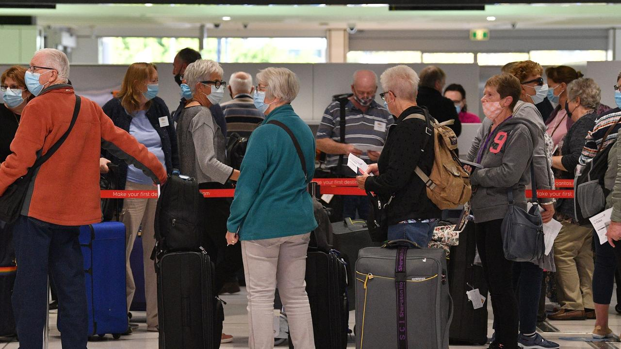 Passengers wait at the check-in for New Zealand flights at Sydney International Airport on the first day of the trans-Tasman quarantine-free travel bubble. Picture: Saeed Khan/AFP