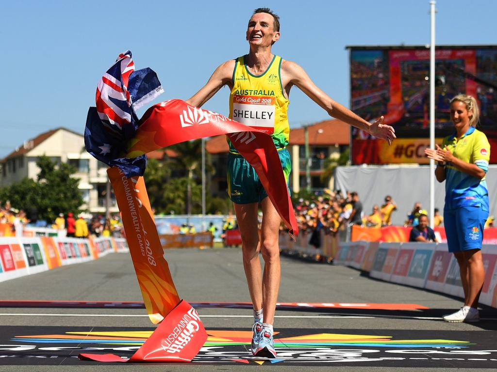 Michael Shelley of Australia celebrates as he crosses the line to win gold in the Men's marathon.