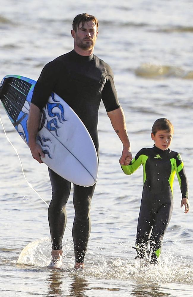 One of Hemsworth's mini-me sons gripped his dad's hand during the outing. Picture: MediaMode.