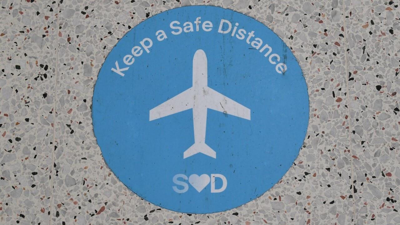 NSW, Qld, WA cut overseas arrivals by half