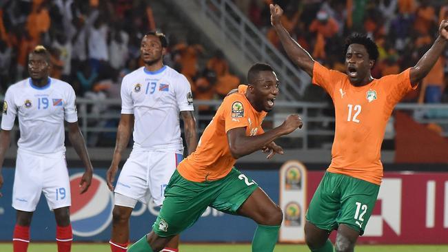 Ivory Coast's defender Serge Wilfried Kanon (2nd-R) celebrates with forward Wilfried Bony.