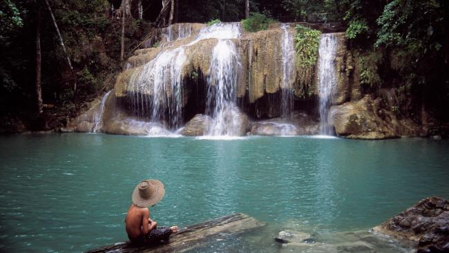 8/41Erawan Falls - Erawan National Park, Thailand Away from the frantic pace of the capital Bangkok, this national park in the hills of western Thailand is a breath of fresh air for the southeast Asia traveller. Erawan National Park has deciduous forests, wildlife, limestone caves and - of course - waterfalls, streams and pools. The most famous of these are the seven-tiered Erawan Falls, that tumble into emerald-green plunge pools. Entry for an adult foreigner costs 400 baht (about $18 AUD).