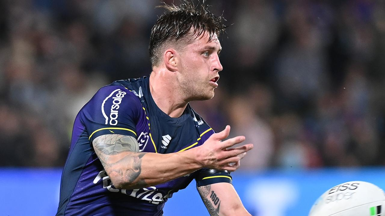 SUNSHINE COAST, AUSTRALIA - SEPTEMBER 10: Cameron Munster of the Storm offloads the ball during the NRL Qualifying Final between the Melbourne Storm and the Manly Warringah Sea Eagles at Sunshine Coast Stadium on September 10, 2021, in Sunshine Coast, Australia. (Photo by Bradley Kanaris/Getty Images)