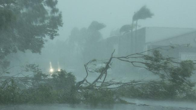 Winds create destruction as Tropical Cyclone Marcus bears down on Darwin, Saturday, March 17, 2018. Tropical Cyclone Marcus has been strengthening as it headed towards Darwin, and residents of the city have been told to brace for winds of more than 130 kilometres an hour. (AAP Image/Glenn Campbell) NO ARCHIVING