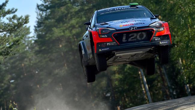 Hayden Paddon of New Zealand and John Kennard of New Zealand get some serious air in their Hyundai Motorsport WRT Hyundai i20 WRC during the Shakedown of the WRC Finland.