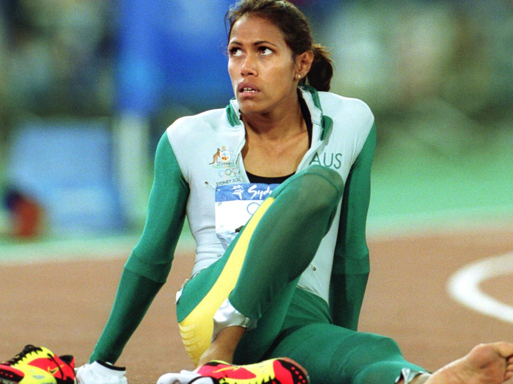 Athletics - Aust athlete Cathy Freeman sitting on track after winning womens 400m final race at Sydney Olympic Games 25 Sep 2000.