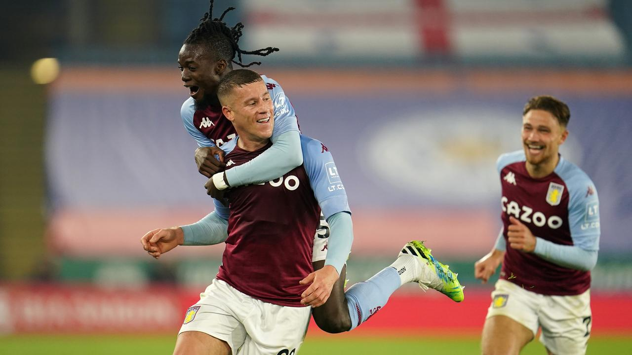 Ross Barkley of Aston Villa celebrates with teammates Bertrand Traore and Matty Cash after scoring his team's winning goal. (Photo by Jon Super - Pool/Getty Images)