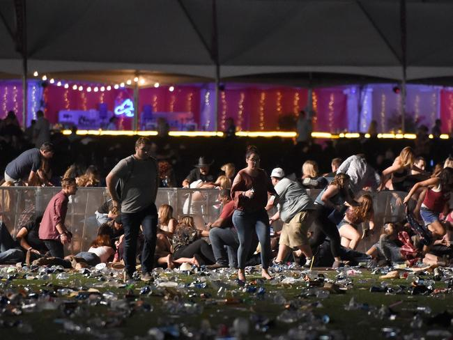 People run from the Route 91 Harvest country music festival amid gun shots. Picture: David Becker/Getty Images/AFP