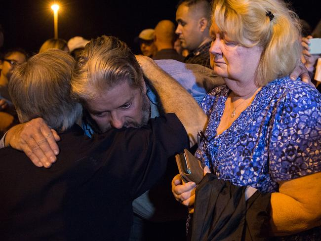 Ted and Ann Montgomery, employees at the First Baptist Church, are comforted by Texas Governor Greg Abbott. left. Picture: Suzanne Cordeiro/AFP