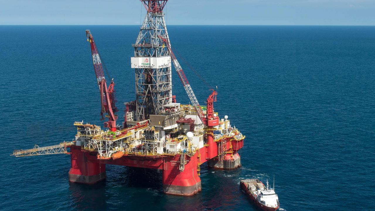 A ratings agency is unimpressed by BHP's plan to offload its oil and gas assets to Woodside. Picture: Omar Torres/AFP