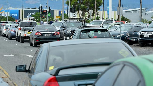 Cars were banked up and overflowing on West Beach Rd as they headed to Harbour Town West Beach, for the Boxing Day sales. Picture: Bianca De Marchi